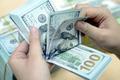 Giá bán USD chợ đen giảm về 23.200 VND/USD