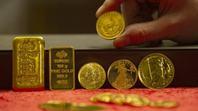 Đà lên giá đồng USD tạo sức ép cho giá vàng